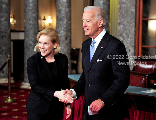 United States Senator Kirsten Gillibrand (Democrat of New York), left, shakes hands with U.S. Vice President Joe Biden, right as she arrives in the Old Senate Chamber for the photo-op of the reenactment of her swearing-in in the U.S. Capitol in Washington, D.C. on Wednesday, January 5, 2011. .Credit: Ron Sachs / CNP.(RESTRICTION: NO New York or New Jersey Newspapers or newspapers within a 75 mile radius of New York City)