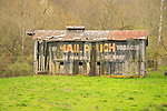 Dilapidated barn with Mail Pouch Tobacco sign.