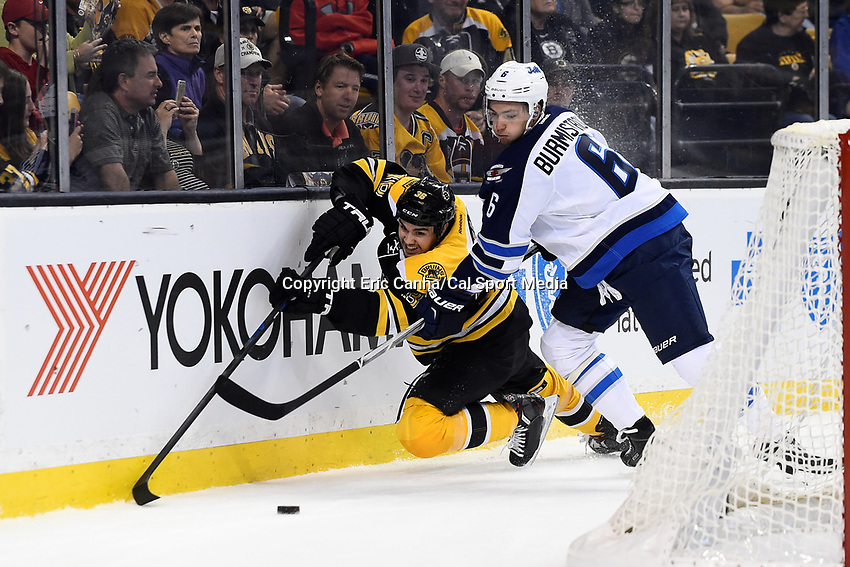 Thursday, October 8, 2015: Winnipeg Jets center Alex Burmistrov (6) and Boston Bruins center Zac Rinaldo (36) battle for the puck behind the net during the NHL game between the Winnipeg Jets and the Boston Bruins held at TD Garden, in Boston, Massachusetts. Winnipeg defeated Boston 602 in regulation time. Eric Canha/CSM