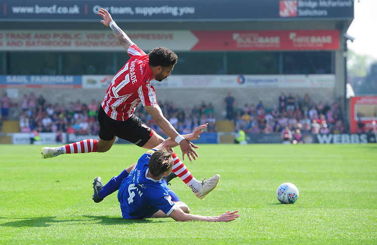 Lincoln City's Bruno Andrade vies for possession with Tranmere Rovers' Sid Nelson<br /> <br /> Photographer Chris Vaughan/CameraSport<br /> <br /> The EFL Sky Bet League Two - Lincoln City v Tranmere Rovers - Monday 22nd April 2019 - Sincil Bank - Lincoln<br /> <br /> World Copyright © 2019 CameraSport. All rights reserved. 43 Linden Ave. Countesthorpe. Leicester. England. LE8 5PG - Tel: +44 (0) 116 277 4147 - admin@camerasport.com - www.camerasport.com