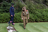 Australian military personnel look at graves of fallen serviceman and servicewomen during the  Remembrance Sunday ceremony at the Hodogaya, Commonwealth War Graves Cemetery in Hodogaya, Yokohama, Kanagawa, Japan. Sunday November 11th 2018. The Hodagaya Cemetery holds the remains of more than 1500 servicemen and women, from the Commonwealth but also from Holland and the United States, who died as prisoners of war or during the Allied occupation of Japan. Each year officials from the British and Commonwealth embassies, the British Legion and the British Chamber of Commerce honour the dead at a ceremony in this beautiful cemetery. The year 2018 marks the centenary of the end of the First World War in 1918.