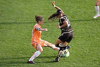 Julianne Sitch (left) tries to steal the ball from Adriane (21). FC Gold Pride defeated Sky Blue FC 1-0 at Buck Shaw Stadium in Santa Clara, California on May 3, 2009.