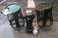 New York, NY -  29 Oct 2012 Trash cans upside down to reduce risk of hurting anyone, or flying through the air during Hurricane Sandy. There are over 25,000 corner trash cans and baskets in New York.