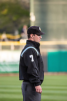 Umpire Jordan Ferrell handles the calls on the bases during the Pacific Coast League game between the Salt Lake Bees and the Sacramento River Cats at Smith's Ballpark on April 17, 2015 in Salt Lake City, Utah.  (Stephen Smith/Four Seam Images)