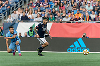 FOXBOROUGH, MA - SEPTEMBER 29: Gustavo Bao #7 of New England Revolution on the attack during a game between New York City FC and New England Revolution at Gillette Stadium on September 29, 2019 in Foxborough, Massachusetts.