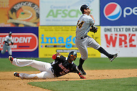 Kennys Vargas (35) of the New Britain Rock Cats slides into second base as Rob Refsnyder #24 of the Trenton Thunder throws to first during a game on at New Britain Stadium on May 7,  2014 in New Britain, Connecticut.  Trenton defeated New Britain 6-4. (Gregory Vasil/Four Seam Images)