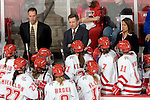 MADISON, WI - SEPTEMBER 29: Head coach Mark Johnson (top center) of the Wisconsin Badgers women's hockey team talks to his team during a timeout  against the Quinnipiac Bobcats at the Kohl Center on September 29, 2006 in Madison, Wisconsin. The Badgers beat the Bobcats 3-0. (Photo by David Stluka)