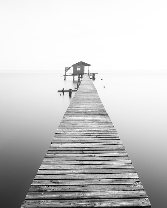 An impressionistic view of an old boathouse along the St. John's River on a foggy morning.