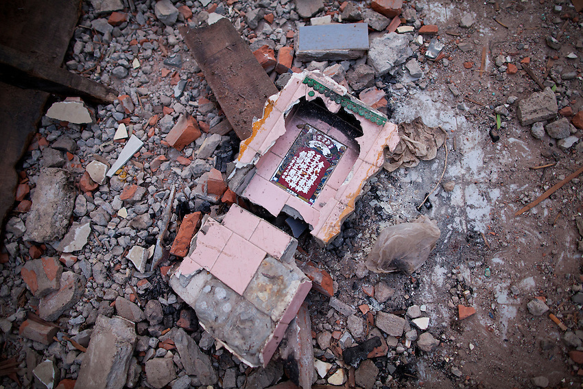 A Buddhist spirit house lies broken in two on the ground following a forced eviction at Boeung Kak lake, during which police and security guards employed by Shukaku Inc man-handled villagers and photojournalists and dismantled the homes of more than 20 families.