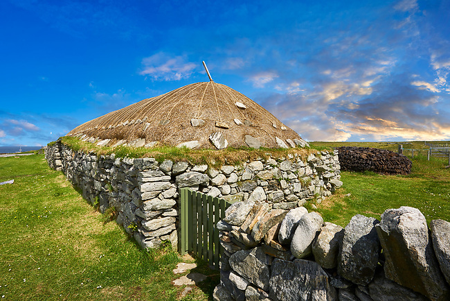 Picture & image of the exterior with stone walls and thatched roof of The historic Blackhouse, 24 Arnol, Bragar, Isle of Lewis, Scotland.