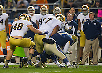 Pittsburgh quarterback Tom Savage (7) is hit by Notre Dame Fighting Irish defensive end Stephon Tuitt (7) in the second quarter at Heinz Field. Tuitt was called for targeting and ejected from the game.