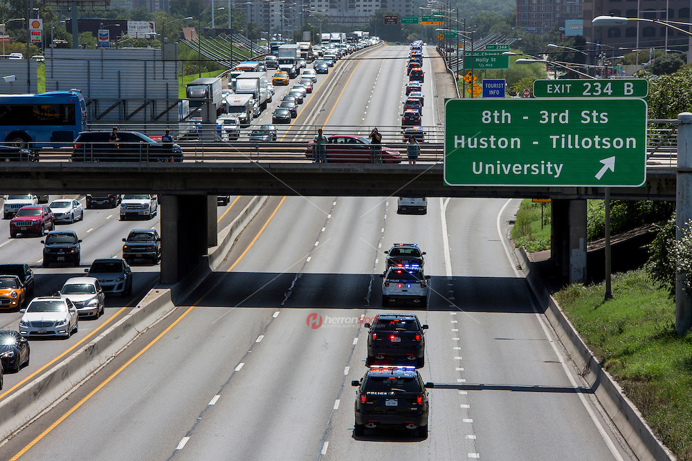 APD motorcade funeral procession with police car lights flashing travels southbound through downtown on Interstate 35 for Austin police officer Amir Abdul-Khaliq on Thursday September 8, 2016 - Stock Image.<br /> <br /> Use of this image in advertising or for promotional purposes is prohibited.<br /> <br /> Editorial Credit: Dan Herron / Herronstock Editorial.
