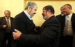 FILE PHOTO: A handout photograph released by the Hamas Press Office shows Leaders of the newly formed Freedom and Justice Party, President Mohammed Morsy, meets with Palestinian Hamas leader Khaled Meshaal (R) in Cairo, Egypt, 21 January 2012. Former President Mohamed Morsi died on Monday in court after the conclusion of a trial session in the espionage lawsuit, Egyptian state TV said. Photo by Mohammed al-Hams