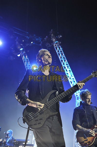 John Taylor.Duran Duran performing live in concert, O2 Arena, Greenwich, London, England. 12th December 2011.on stage gig performance music half length black suit jacket bass guitar.CAP/MAR.© Martin Harris/Capital Pictures.