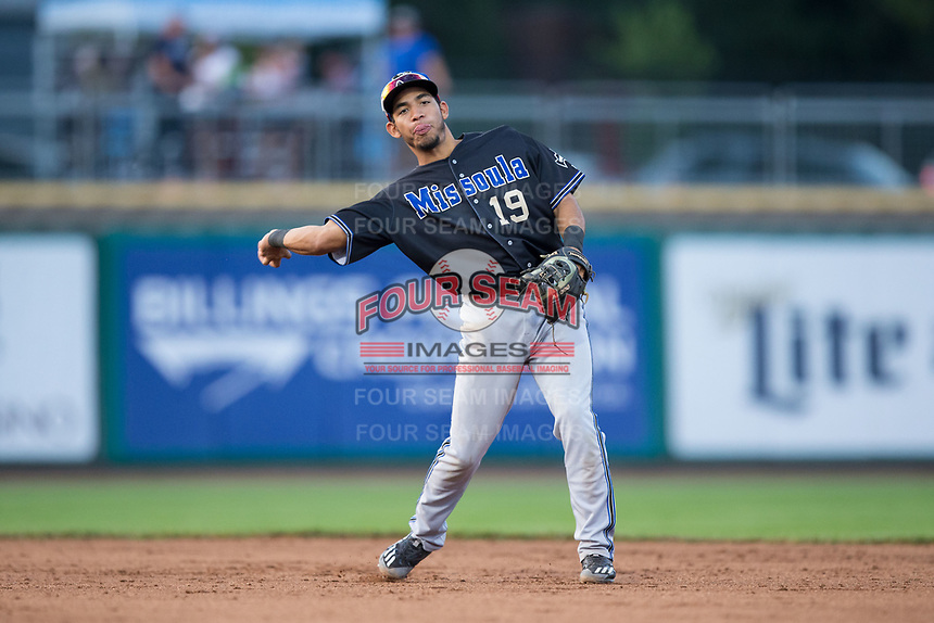Missoula Osprey second baseman Jose Caballero (19) makes a throw to first base between innings of the game against the Billings Mustangs at Dehler Park on August 21, 2017 in Billings, Montana.  The Osprey defeated the Mustangs 10-4.  (Brian Westerholt/Four Seam Images)