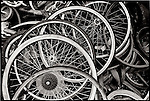 Old bicycle wheels in a junkyard.