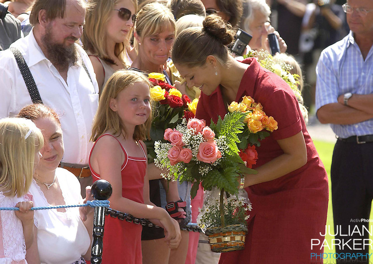CROWN PRINCESS VICTORIA OF SWEDEN CELEBRATES HER 25TH BIRTHDAY, .WITH HER PARENTS, AT SOLLIDEN, NEAR BERGHOLM, SWEDEN..14/7/02.  PICTURE: UK PRESS   (ref 5105-7)