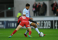 Racing 92 Ben Volavola kicks the ball while under pressure from Scarlets' Angus O'Brian<br /> <br /> Photographer Ian Cook/CameraSport<br /> <br /> European Rugby Champions Cup - Scarlets v Racing 92 - Saturday 13th October 2018 - Parc y Scarlets - Llanelli<br /> <br /> World Copyright © 2018 CameraSport. All rights reserved. 43 Linden Ave. Countesthorpe. Leicester. England. LE8 5PG - Tel: +44 (0) 116 277 4147 - admin@camerasport.com - www.camerasport.com