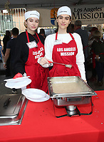 21 December 2018 - Los Angeles, California - Delilah Hamlin and Amelia Hamlin. Los Angeles Mission Christmas Meal for the Homeless held at Los Angeles Mission. Photo Credit: F. Sadou/AdMedia
