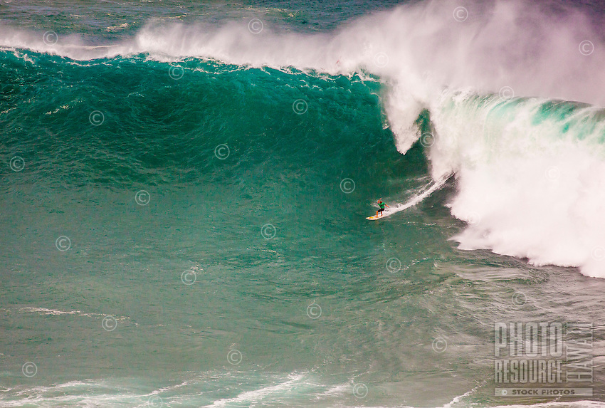 A surfer rides a wave at the 2016 Big Wave Eddie Aikau Contest, Waimea Bay, North Shore, O'ahu.
