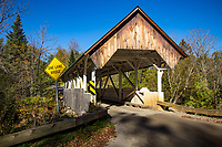 The Greenbanks Hollow Covered Bridge is a historic covered bridge, carrying Greenbanks Hollow Road across Joes Brook in southern Danville, Vermont. It is the only surviving 19th-century covered bridge in the town. It was listed on the National Register of Historic Places in 1974.<br /> <br /> The Greenbanks Hollow Covered Bridge is located in a rural area of southern Danville, spanning Joes Brook, an east-flowing tributary of the Connecticut River. Greenbanks Hollow Road is a minor through road between Danville and Peacham. It is a single-span queen post truss structure, with flanking trusses of unequal length. The western truss is 73 feet  long, while the eastern one is 1.5 feet  longer, the skew visible at the southern portal. The bridge is 16.5 feet (5.0 m) wide, with a roadway width of 15 feet, carrying one lane of traffic. It is covered by a metal gabled roof with broad eaves. The side walls are covered to about half their height with vertical board siding, which is extended around the full height of the portals. The bridge rests on abutments of stone and concrete; the northern one has been rebuilt after its original stone abutment collapsed.<br /> <br /> The bridge's construction date and builder are not known. Vermont historian Herbert Congdon claims that the bridge was originally uncovered, and that its roof is a later addition. It is stylistically similar to the bridges located in nearby Lyndon, which also feature queen post trusses, half-height siding, and broad roofs. It is the only surviving 19th-century covered bridge in the town of Danville.