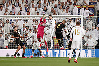 26th February 2020; Estadio Santiago Bernabeu, Madrid, Spain; UEFA Champions League Football, Real Madrid versus Manchester City; Sergio Ramos (Real Madrid) challenges for the header with Ederson Moraes (Manchester City)