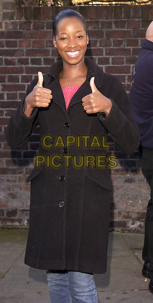 """JAMEILA.at the 20th anniversary  re-recording of the 1984 charity single """"Do They Know Its Christmas"""" (Band Aid 20) Air Studios, Hampstead, London..November 14th 2004..half length thumbs up black coat gesture.Ref: FIN.www.capitalpictures.com.sales@capitalpictures.com.©Steve Finn/Capital Pictures ."""