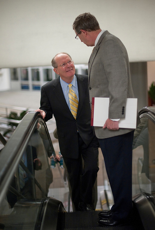 UNITED STATES - August 2: Lamar Alexander, R-TN., and Kent Conrad, D-ND., talk as they enter the U.S. Capitol from the Senate subway on August 2, 2011. (Photo By Douglas Graham/Roll Call)
