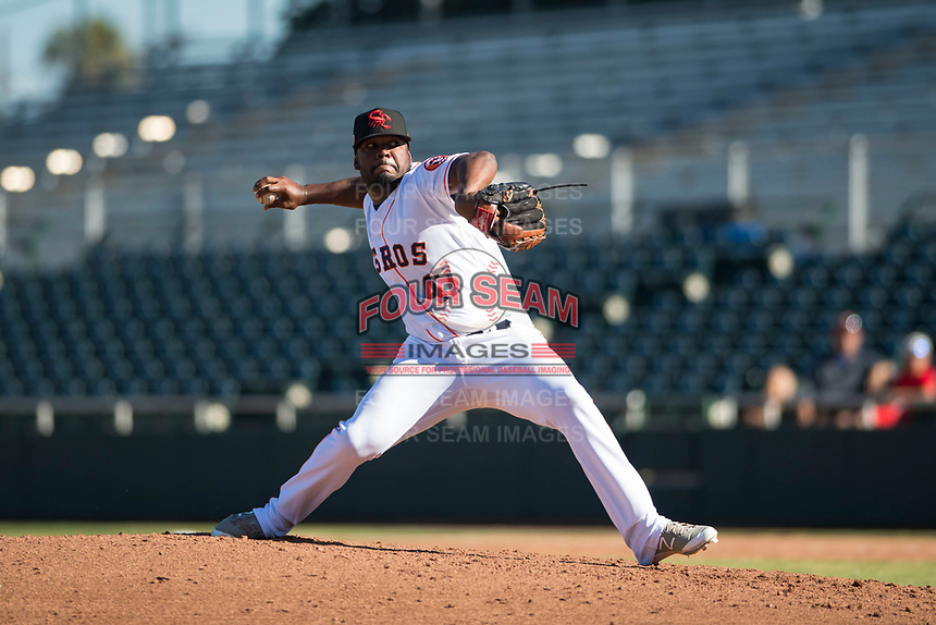 Scottsdale Scorpions relief pitcher Erasmo Pinales (47), of the Houston Astros organization, delivers a pitch during an Arizona Fall League game against the Surprise Saguaros at Scottsdale Stadium on October 26, 2018 in Scottsdale, Arizona. Surprise defeated Scottsdale 3-1. (Zachary Lucy/Four Seam Images)