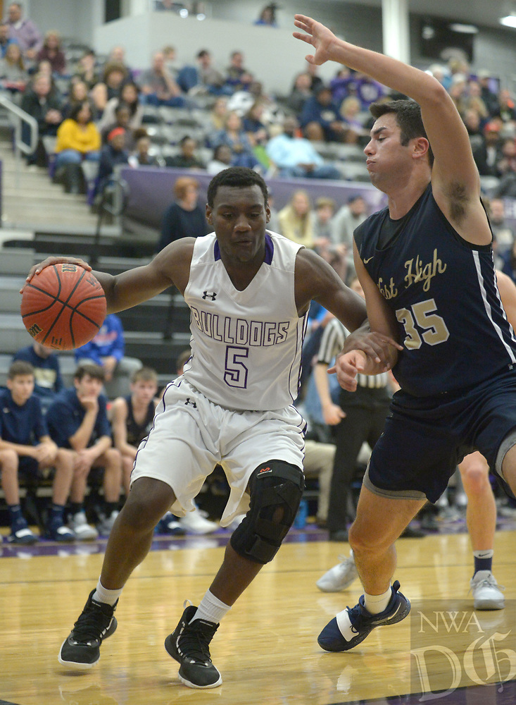 NWA Democrat-Gazette/ANDY SHUPE<br /> Fayetteville's Darius Bowers (5) drives to the lane as he is guarded by Bentonville West's Austin Conner Friday, Jan. 4, 2018, during the first half of play in Bulldog Arena. Visit nwadg.com/photos to see more photographs from the game.