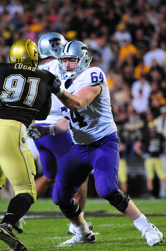 18 October 08: Kansas State tackle Nick Stringer (64) works against Colorado defensive end Maurice Lucas (91). The Colorado Buffaloes defeated the Kansas State Wildcats 14-13 at Folsom Field in Boulder, Colorado.