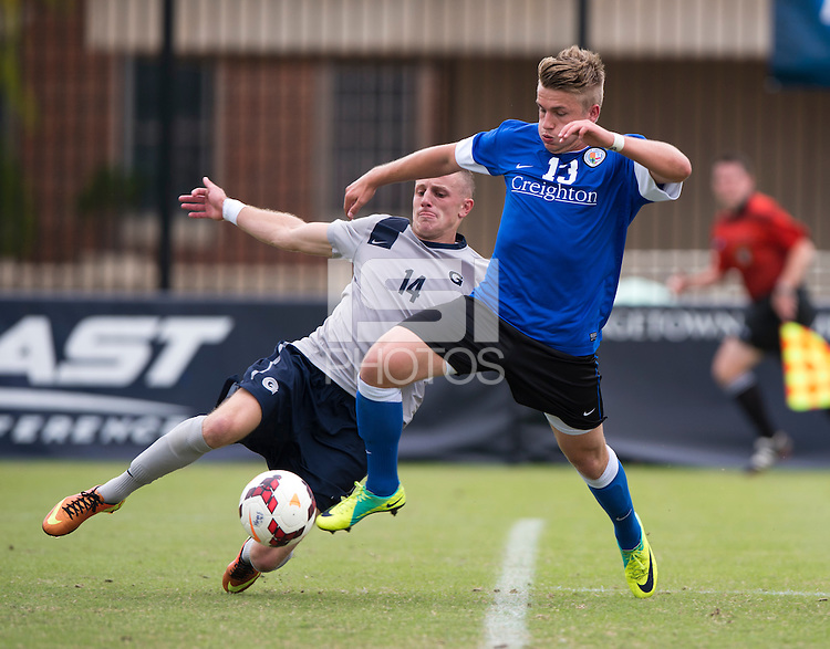 Cole Seiler (14) of Georgetown tries to tackle Marvin Iskra (13) of Creighton during the game at Shaw Field on the campus of the Georgetown University in Washington, DC.  Georgetown tied Creighton, 0-0, in double overtime.