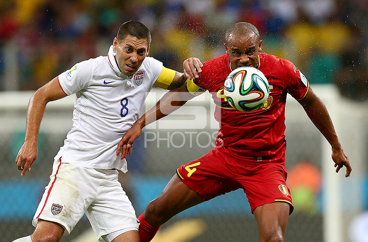 Clint Dempsey of USA and Vincent Kompany of Belgium in action