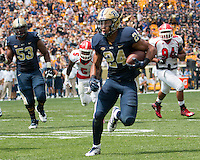 Pitt running back James Conner (24) scores on a 13-yard touchdown run. The Pitt Panthers football team defeated the Youngstown State Penguins 45-37 on Staturday, September 5, 2015 at Heinz Field, Pittsburgh, Pennsylvania.