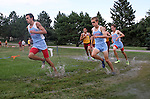 SIOUX FALLS, SD - SEPTEMBER 3:  Runners slosh through a wet track after the city decided to drain Kuehn Park swimming pool at the Mack Butler Cross Country Invitational Tuesday at Kuehn Park. (Photo by Dave Eggen/Inertia)