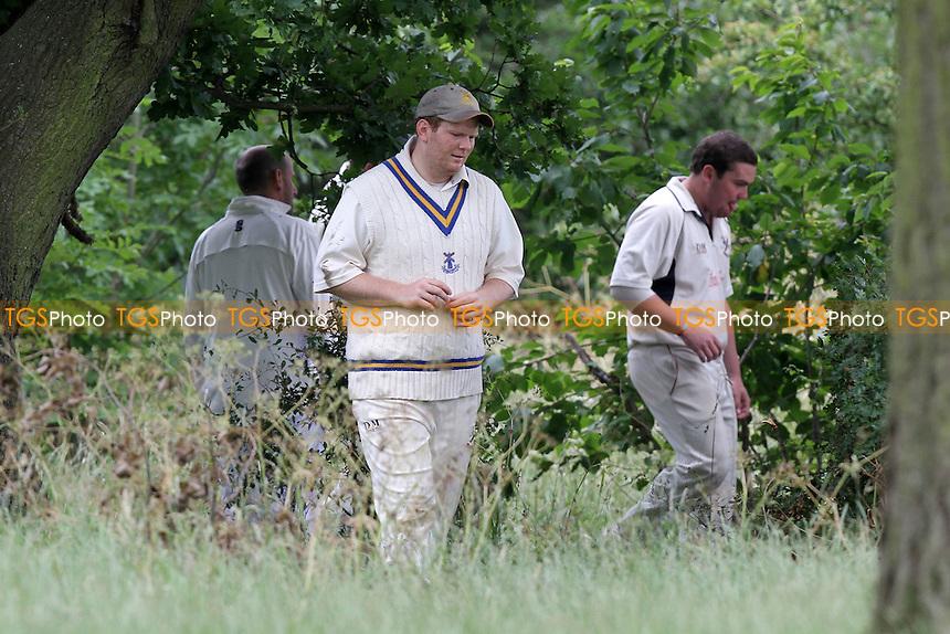 The search for the ball continues - Gidea Park & Romford CC (batting) vs Upminster CC - Essex Cricket League Dukes Twenty20 Competition - 18/06/11 - MANDATORY CREDIT: Gavin Ellis/TGSPHOTO - Self billing applies where appropriate - Tel: 0845 094 6026