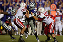 October 07, 2010: Kansas State defensive tackle Prizell Brown (46) gets a hold of Nebraska quarterback Taylor Martinez (3) at the Bill Snyder Family Stadium in Manhattan, Kansas.  Nebraska defeated Kansas State 48 to 13.
