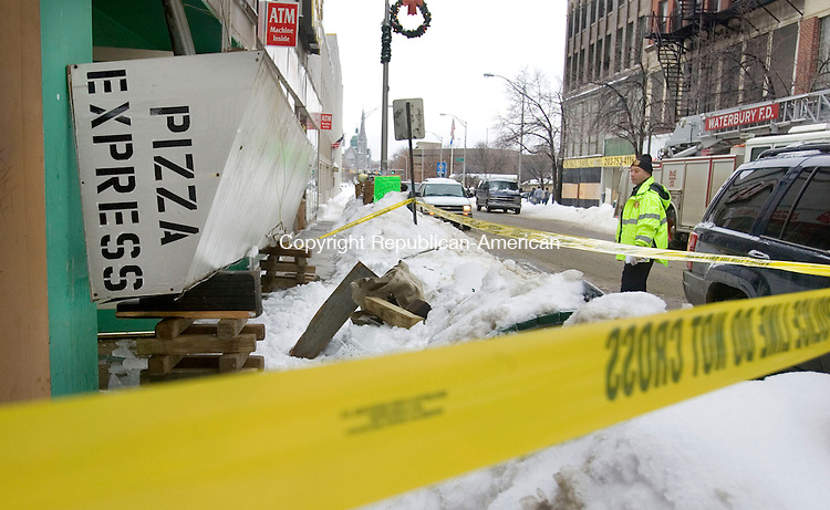 WATERBURY, CT. 02 February 2011-020211SV06--An awning at Pizza Express collapsed under the weight of the show on Bank Street in Waterbury Tuesday. Injuries were reporter on scene.<br /> Steven Valenti Republican-American