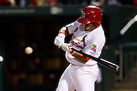 Kolten Wong (4) of the Springfield Cardinals swings at a pitch during a game against the Arkansas Travelers at Hammons Field on July 25, 2012 in Springfield, Missouri. (David Welker/Four Seam Images)
