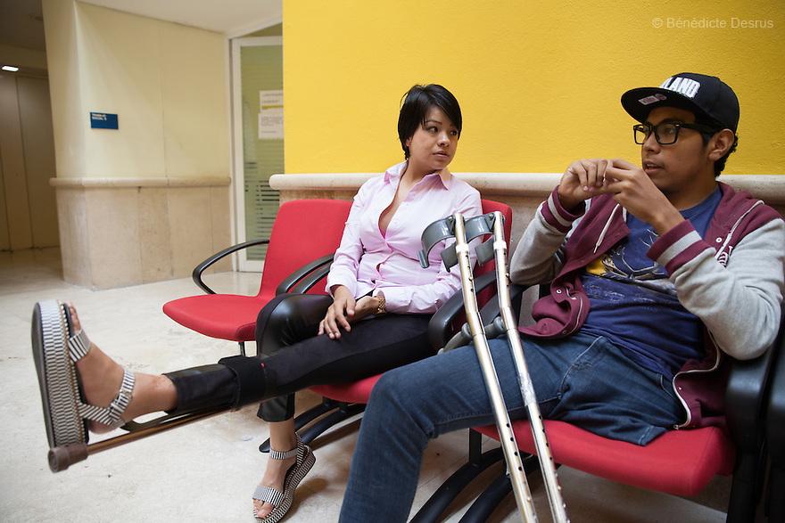 "Baruch (R) talks with Nancy (L), another patient who has bone cancer, in the waiting room of the Oncology Department of the National Institute of Rehabilitation in Mexico City, Mexico on June 27, 2014. Baruch Alejandro Anleu Ramirez, 18, is the captain of Guerreros Aztecas. Two years ago, Baruch had his left leg amputated due to bone cancer. He used to practice as much as his chemotherapy would allow. Expelled from school for missing too many classes during his treatment, he says, ""Guerreros Aztecas has filled a big hole in my life"". Baruch was Guerreros Aztecas's brightest hope to represent Mexico at the Amputee Soccer World Cup. But since the cancer's spread to his lungs, he can no longer play or train with the team. Guerreros Aztecas (""Aztec Warriors"") is Mexico City's first amputee football team. Founded in July 2013 by five volunteers, they now have 23 players, seven of them have made the national team's shortlist to represent Mexico at this year's Amputee Soccer World Cup in Sinaloa this December. The team trains twice a week for weekend games with other teams. No prostheses are used, so field players missing a lower extremity can only play using crutches. Those missing an upper extremity play as goalkeepers. The teams play six per side with unlimited substitutions. Each half lasts 25 minutes. The causes of the amputations range from accidents to medical interventions – none of which have stopped the Guerreros Aztecas from continuing to play. The players' age, backgrounds and professions cover the full sweep of Mexican society, and they are united by the will to keep their heads held high in a country where discrimination against the disabled remains widespread. (Photo by Bénédicte Desrus)"