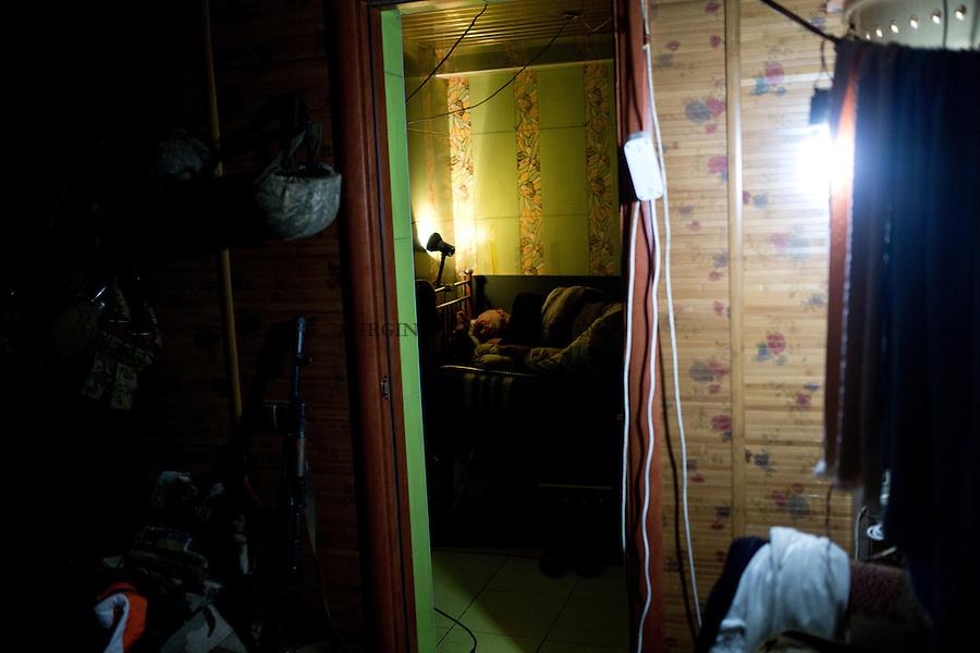 UKRAINE, Pisky: Yasin sleeping in in bedroom that was probably one of the bathrooms of the house before the war.<br /> <br /> UKRAINE, Pisky: Yasin dort dans sa chambre qui &eacute;tait probablement l'une des salles de bains de la maison avant la guerre.