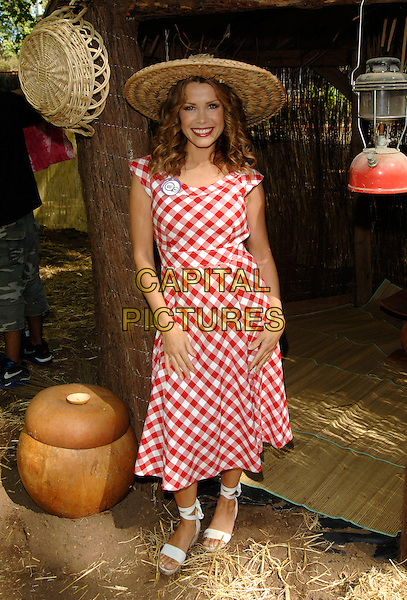 MELINDA MESSENGER.Attendig a photocall to launch World Vision School Aid, Coram's Fields, Guilford Strret,.London, England, May 2nd 2007..full length red and white gingham dress lipstick shoes sandals straw hat funny.CAP/PL.©Phil Loftus/Capital Pictures