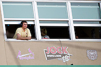 Jeff Levering, voice of the Springfield Cardinals hangs his head out of the window during a game between the Northwest Arkansas Naturals and the Springfield Cardinals at Hammons Field on August 1, 2011 in Springfield, Missouri. Springfield defeated Northwest Arkansas 7-1. (David Welker / Four Seam Images)