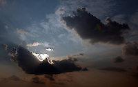 Rick Wilson Photo--8/5/04--A cloud obscures the sun during a late afternoon Summer day in Jacksonville, Florida.