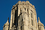 Close up of the top of the University of Bristol Wills Memorial Tower against deep blue sky