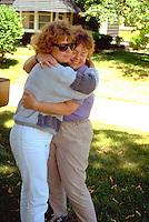 Aunt hugging Niece at grandmothers house.  Beaver Dam Wisconsin USA
