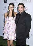 Brett Ratner (R) and guest arrive at 7th Annual Chrysalis Butterfly Ball on May 31, 2008 at a Private Residence in Los Angeles, California.