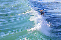 Young Adult Surfing Waves in Huntington Beach