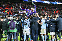 Wilfredo Caballero of Manchester City is held aloft after victory against Liverpool after the Capital One Cup match between Liverpool and Manchester City at Wembley Stadium, London, England on 28 February 2016. Photo by David Horn / PRiME Media Images.