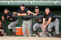 (L-R) Garabez Rosa #32, Matt Hobgood #48, Tony Butler #31 and Mikey Planeta #4 of the Delmarva Shorebirds watch the action from the top step of the dugout at Fieldcrest Cannon Stadium May 12, 2010, in Kannapolis, North Carolina.  Photo by Brian Westerholt / Four Seam Images